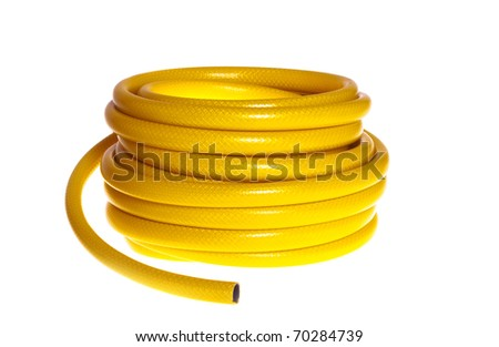 The yellow rubber garden hose on a white background (isolated). - stock photo