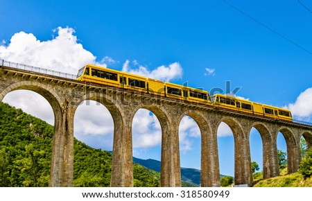 The Yellow Train (Train Jaune) on Sejourne bridge - France, Pyrenees-Orientales - stock photo