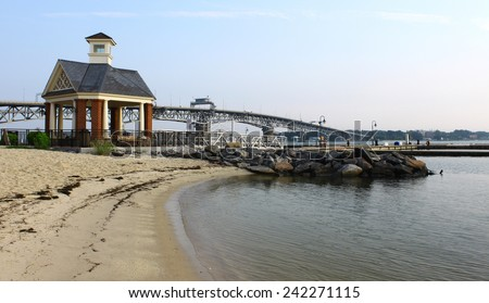 The Yorktown beach and waterfront with the Coleman bridge and a small gazebo type of building in the background on a summer day - stock photo