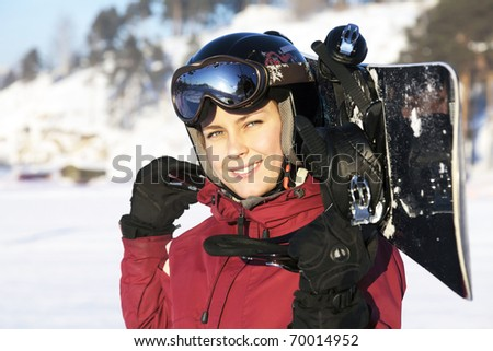 The young adult female snowboarder
