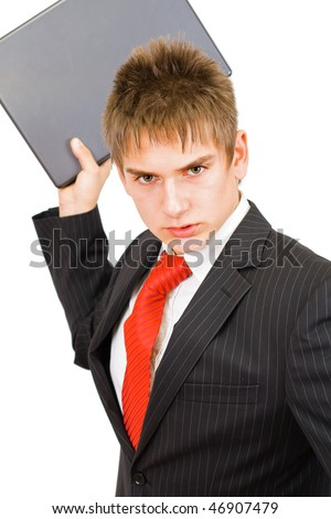 The young angry businessman whit he's laptop - stock photo
