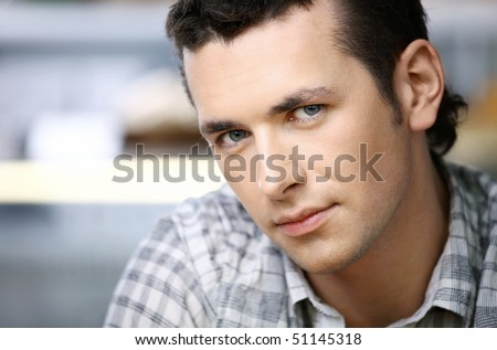 The young attractive man in the foreground - stock photo