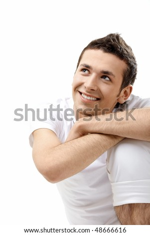 The young attractive man on a white background - stock photo