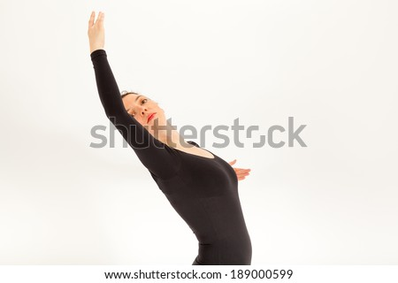 The young ballet dancer is standing in front of the camera - stock photo