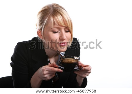 The young beautiful blonde  woman drinks hot fragrant coffee