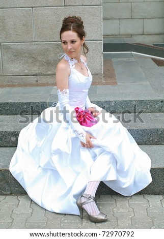 The young beautiful bride against abstract background. Shallow DOF - stock photo