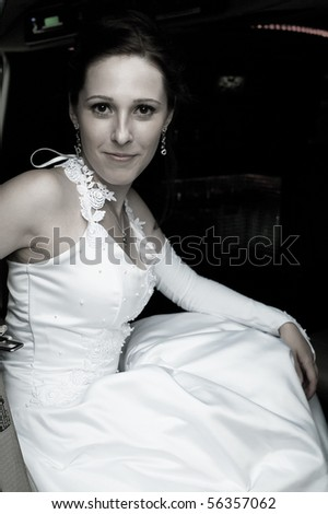 The young beautiful bride in the car. Shallow DOF - stock photo