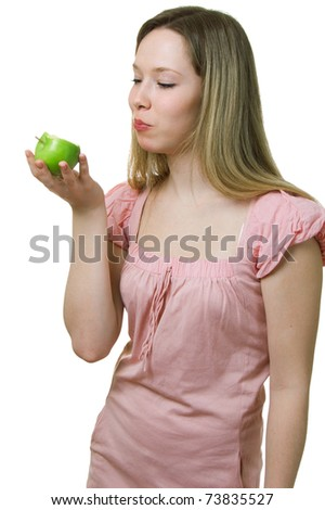 The young beautiful girl eats a green apple. Isolation on a white background