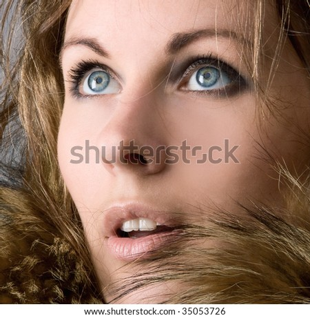 The young beautiful girl in a fur collar