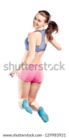 The young beautiful girl in a jump is isolated on the white - stock photo