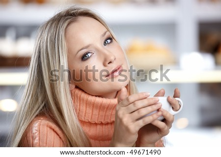 The young beautiful girl with a cup - stock photo