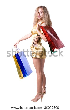 The young beautiful girl with purchases in color packages during shopping on a white background