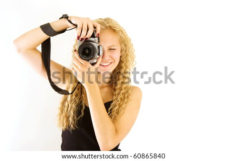 The young beautiful girl with the camera isolated on a white background - stock photo