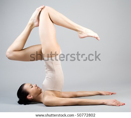 The young beautiful gymnast on training. The master of sports. - stock photo