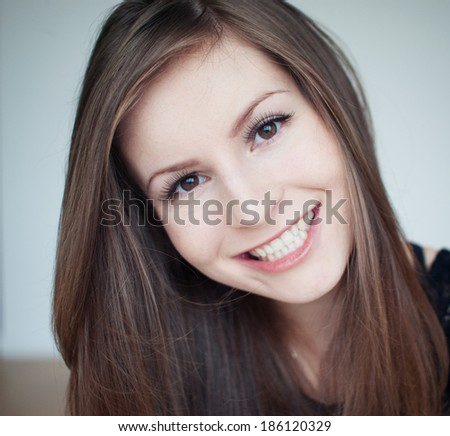 The young beautiful model is smiling, taking a selfie - stock photo