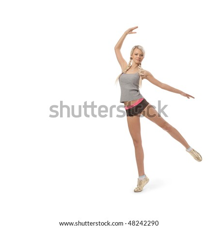 The young beautiful sports girl on a white background - stock photo