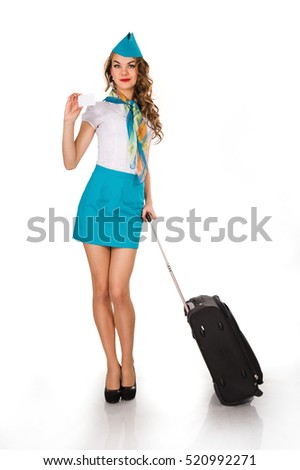 The young, beautiful stewardess holds baggage