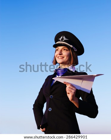 The young beautiful woman in the form of the stewardess, soft focus