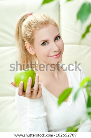 The young beautiful woman with apple - stock photo