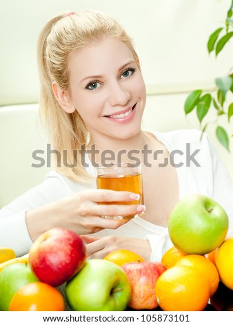 The young beautiful woman with the fresh fruits - stock photo