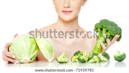 The young beautiful woman with the fresh vegetables, isolated on the white - stock photo