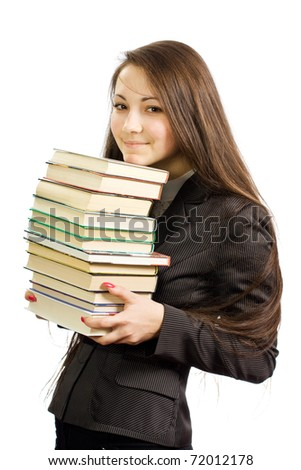 The young beautiful working woman of library with books - stock photo