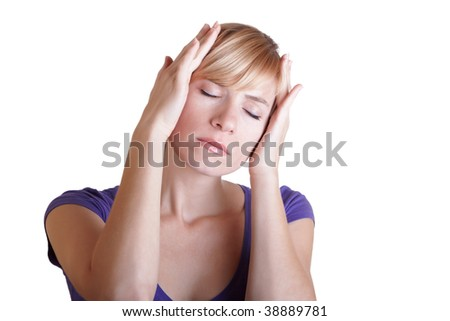 The young blond woman having a headache close up - stock photo