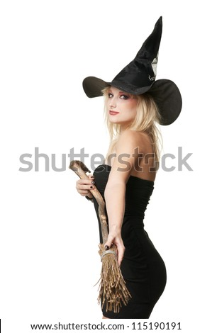 The  young blonde witch with a broom in a black dress