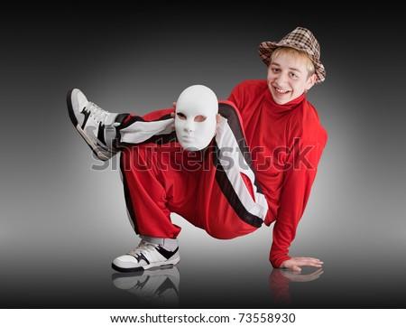 The young boy dances hip-hop - stock photo