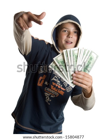 The young boy holds money in hands - stock photo