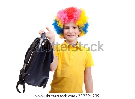 The young boy in clown wig with school satchel - stock photo