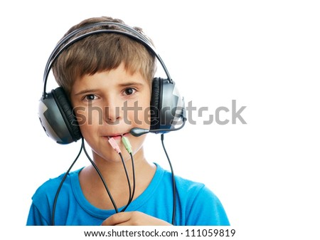 The young boy is listening to music and holding the wire