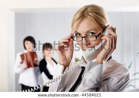 The young business woman at office with colleagues