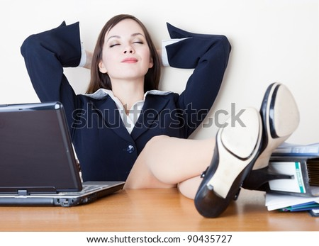 The young business woman is relaxing at work - stock photo