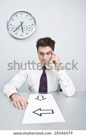 The young businessman has difficulties with events in the decision - stock photo