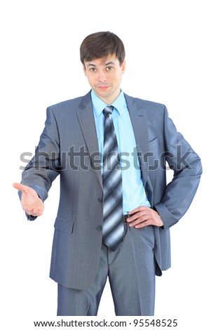 The young businessman he reaches out a hand for a handshake. Isolated on a white background.