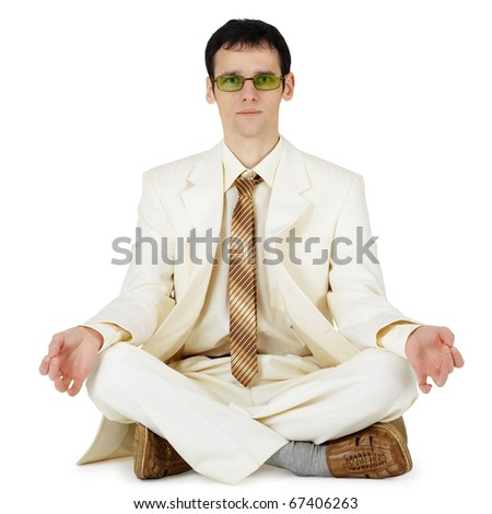 The young businessman in a light suit in an original way relaxes - stock photo