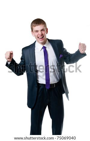 The young businessman in a suit isolated on white background