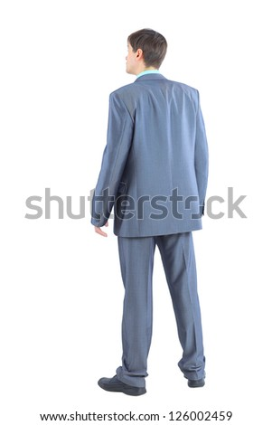 The young businessman is back. Isolated on a white background.