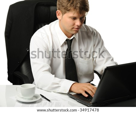 The young businessman on a workplace - stock photo