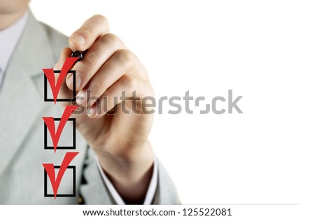 the young businessman ticks off in in a square - stock photo