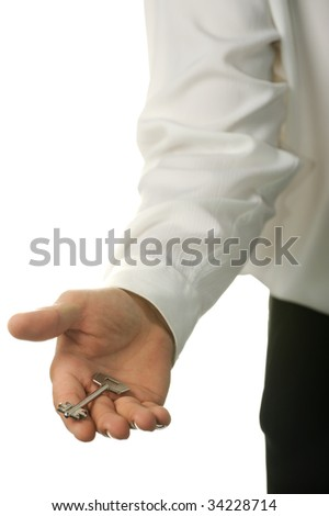 The young businessman with a key in a hand - stock photo