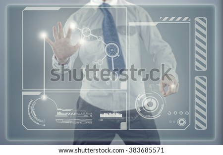 The young businessman works with huge touch screen, modern technology concept - stock photo
