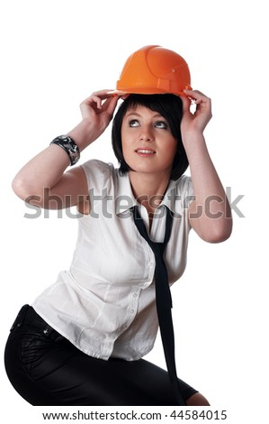 The young charming girl the builder with the measuring tool isolated on white