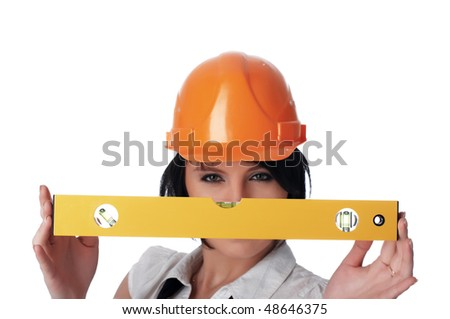 The young charming girl the builder with the measuring tool isolated on white - stock photo