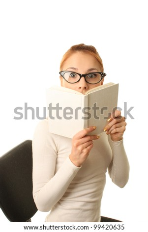 The young cheerful woman wearing glasses and with the book