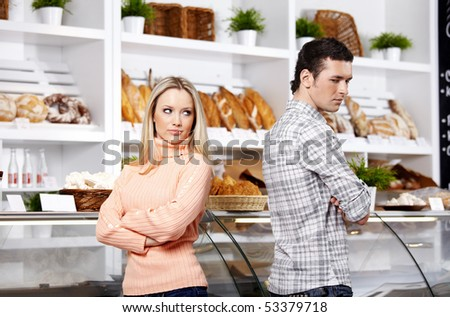 The young couple has turned away from each other in shop - stock photo