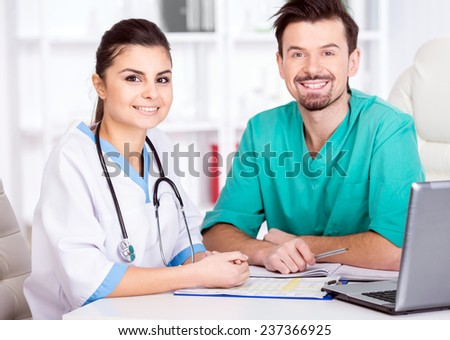 The young doctor and his assistant in a medical office at work. - stock photo