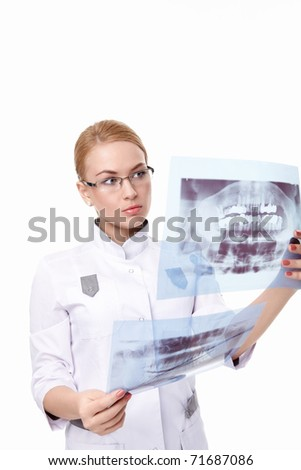 The young doctor examines an x-ray on a white background - stock photo