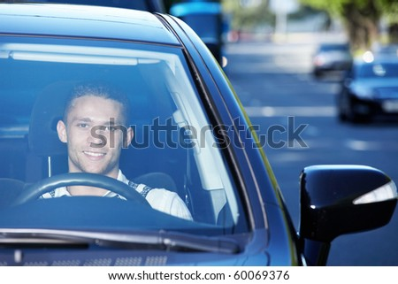 The young driver traveling on a busy highway - stock photo